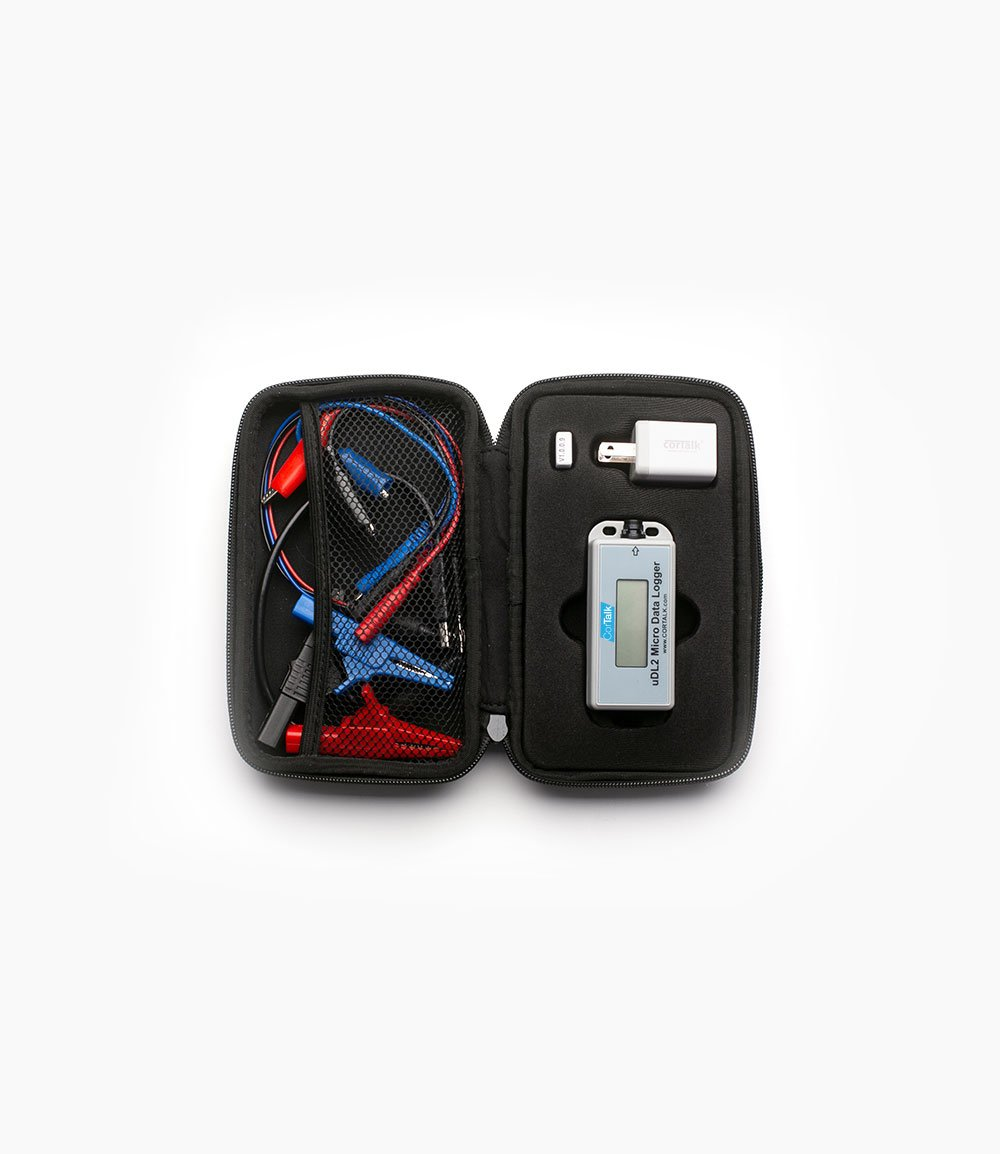 Black carry case with uDL2 Micro Data Logger, power plugin, and cables